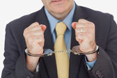 Close-up of businessman with handcuffed hands — Stock Photo