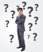 Undecided businessman — Stock Photo