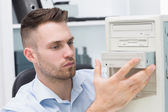 Computer engineer inserting cd - dvd player into computer case — Stock Photo