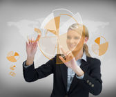 Smiling businesswoman working with graphs — Stock Photo