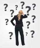 Quizzical businesswoman — Stock Photo