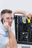 Portrait of computer engineer working on cpu while on call — Stock Photo