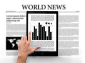 Hand pointing to graph on digital tablet — Stock Photo
