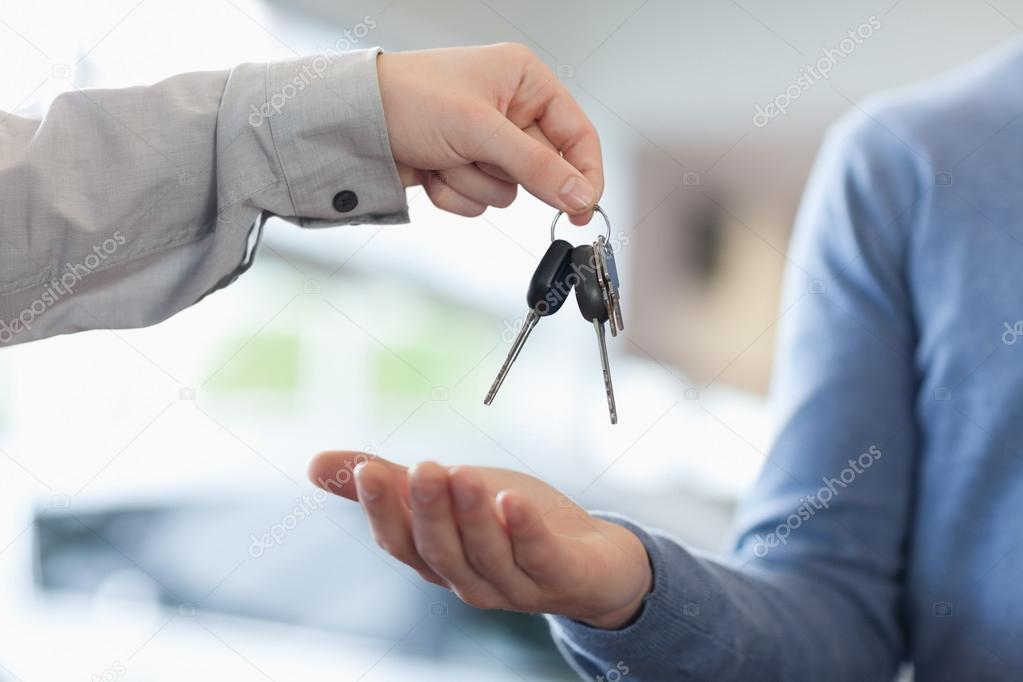 Man Giving Keys To Someone Stock Photo 169 Wavebreakmedia