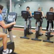 Male instructor teaches spinning class — ストック写真