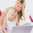 Mother and her daughter using a laptop — Stock Photo