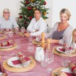 Stock Photo: Smiling family at dinner table