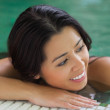 Attractive brunette relaxing in pool — Stock Photo