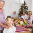 Stock Photo: Grandmother and granddaughter standing beside the dinner table