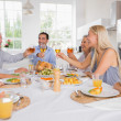 Stock Photo: Adults raising their glasses at thanksgiving dinner