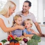 Family tasting vegetables — Stock Photo