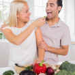 Wife giving vegetable to her husband — Stock Photo
