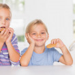 Brother and sister eating biscuits together — Stock Photo #24101851