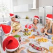 Stock Photo: Family swapping christmas presents