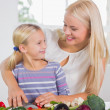 Mother teaching cutting vegetables — Stock Photo #24101887