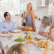 Stock Photo: Mother serving roast turkey