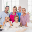 Smiling family preparing to cook — Stock Photo
