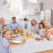 Stock Photo: Happy family going to eat