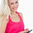 Portrait of happy casual young woman using smartphone — Stock Photo #24102401