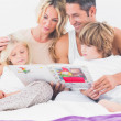 Stock Photo: Family reading a story together