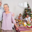 Grandparents standing by the dinner table — Stock Photo