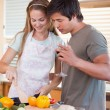 Happy couple cooking food together — Stock Photo