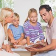 Calm family reading a story together — Stock Photo #24102927