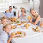 Family raising their glasses at thanksgiving — Stock Photo