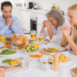 Family praying before dinner — Stock Photo