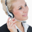 Close-up portrait of young business woman wearing headset — Stock Photo