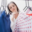 Stock Photo: Womselecting clothing
