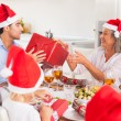 Stock Photo: Family exchanging christmas presents