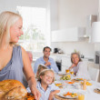 Woman looking her family — Stock Photo