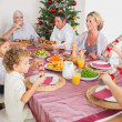 Family having christmas dinner - Lizenzfreies Foto