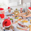 Festive family exchanging gifts - Stock Photo