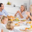 Family enjoying the thanksgiving dinner - Stock Photo