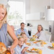 Blonde woman showing the roast turkey — Stock Photo #24104463