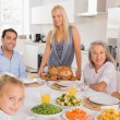 Stock Photo: Happy mother serving a turkey