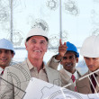 Stock Photo: Smiling architects seeing plcome to life