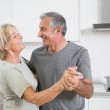 Smiling mature couple dancing together — Stock Photo