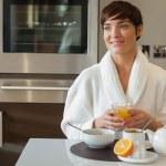 Happy woman having breakfast — Stock Photo #24109125