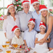 Smiling family at christmas — Stock Photo #24109225