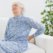 Elderly woman with back pain — Stock Photo #24109399