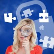 Foto Stock: Woman looking through magnifying glass