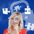 Stock Photo: Woman looking through magnifying glass