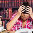 Stressed student in library — Stock Photo #24109797