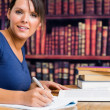 Stock Photo: Smiling woman and writing