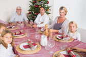 Smiling family at the dinner table — Stock Photo