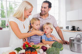 Family tasting vegetables — Stock Photo