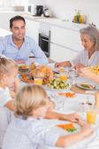 Family eating thanksgiving dinner — Stock Photo